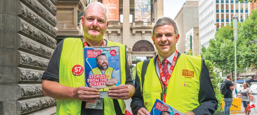 Two men selling the Big Issue