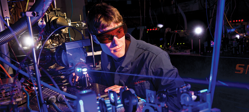 A scientist working with lasers