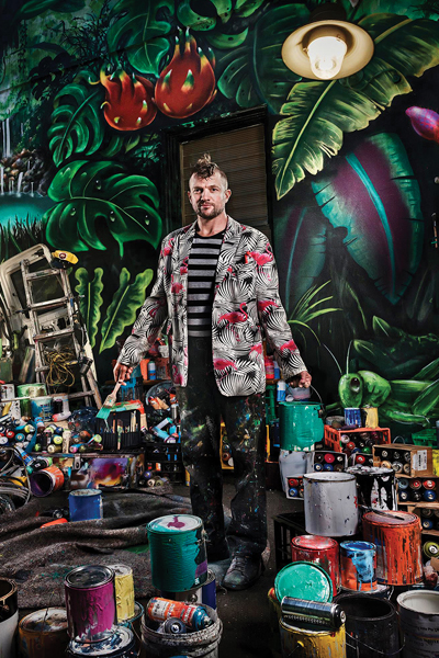 A person with lots of paint cans