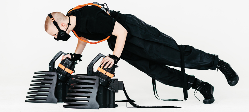 A dancer with industrial equipment