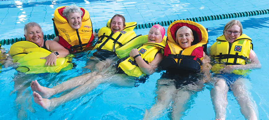 People swimming with life jackets