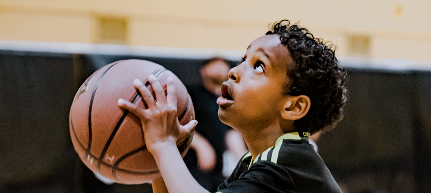 A child about to throw a basketball