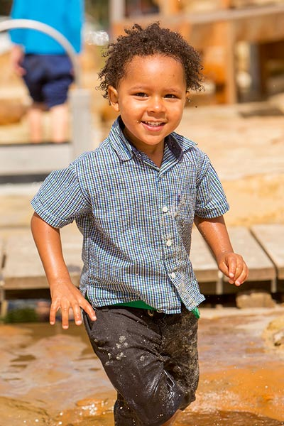 A child playing in shallow water