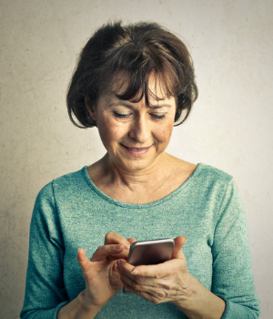 A person looking at a mobile phone