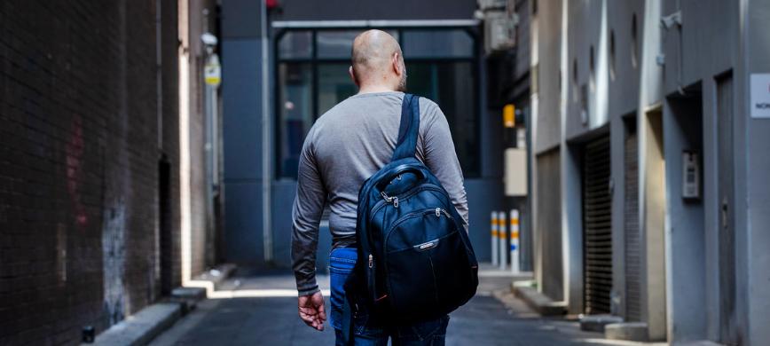 A person walking down a city laneway