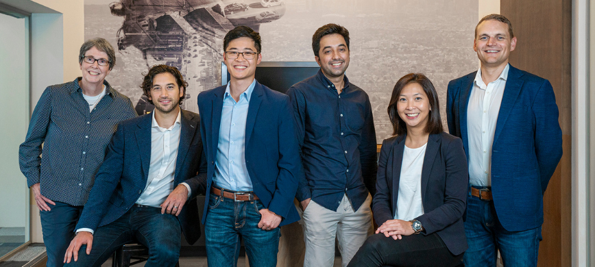 A group of professional people in navy blue office wear