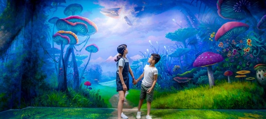 Two children in front of a magical mural, featuring toadstools and a flying whale