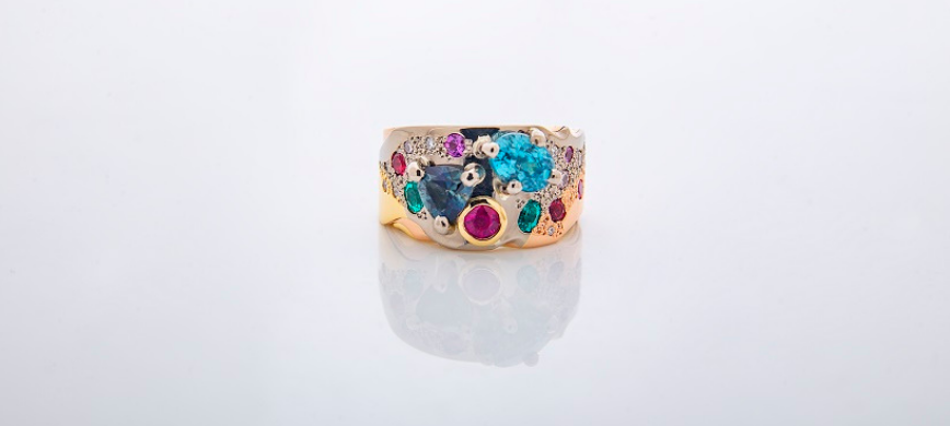 A golden ring with colourful stones